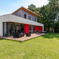maison ossature bois avec baie vitrée d'angle
